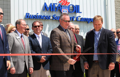 Mark Fenner, MFA Oil president and CEO, cuts the ribbon at the grand opening of the MFA Oil Business Support Campus in Moberly, Mo.