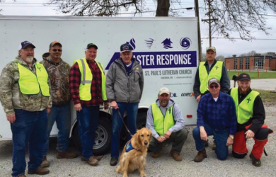 Members of St. Paul's Lutheran Church in Concordia, Mo., use their disaster relief trailer to help clear debris following destructive storms and provide homeowners with assistance in cleanup efforts.