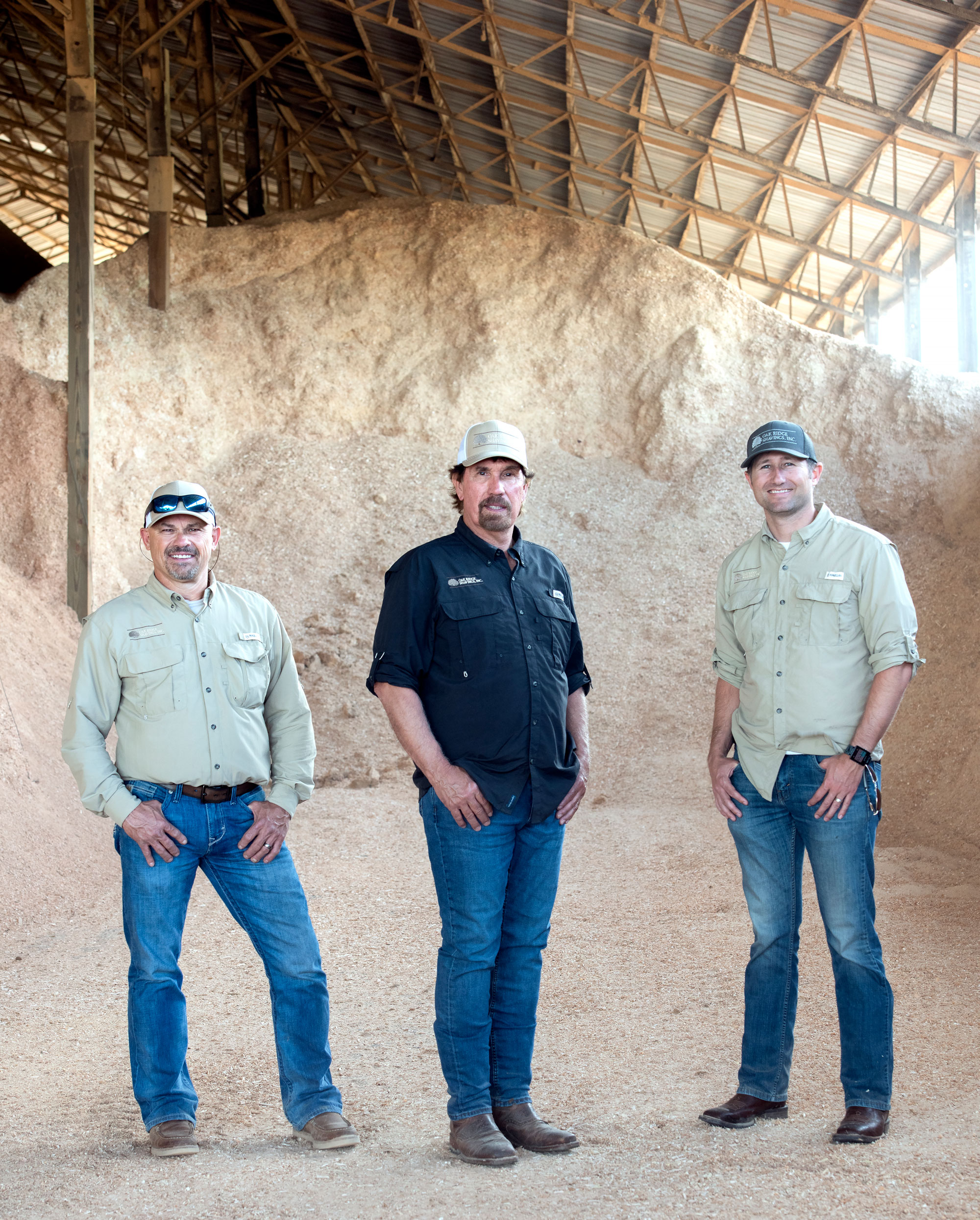 From left, Larry Zebert, Del Oney and Michael Moyer operate Oak Ridge Shavings, a Missouri company that supplies mountains of material for everything from poultry bedding to composite decking.